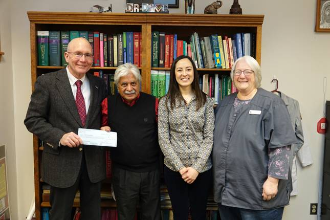 IVCC President Jerry Corcoran, left, accepts a check for $44,131 from La Salle County Medical Society President Dr. Amar Dave of Ottawa who was joined by daughter Pahroul Dave, a family nurse practitioner, and IVCC Foundation President Dr. Sue Schmitt.
