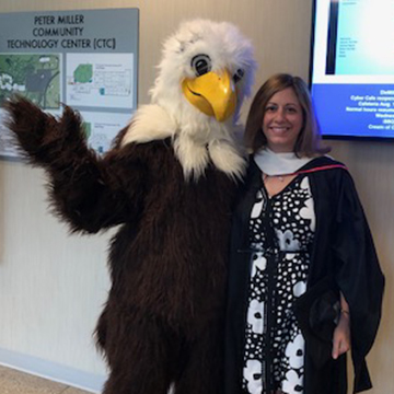 Nora with Spirit, the IVCC mascot
